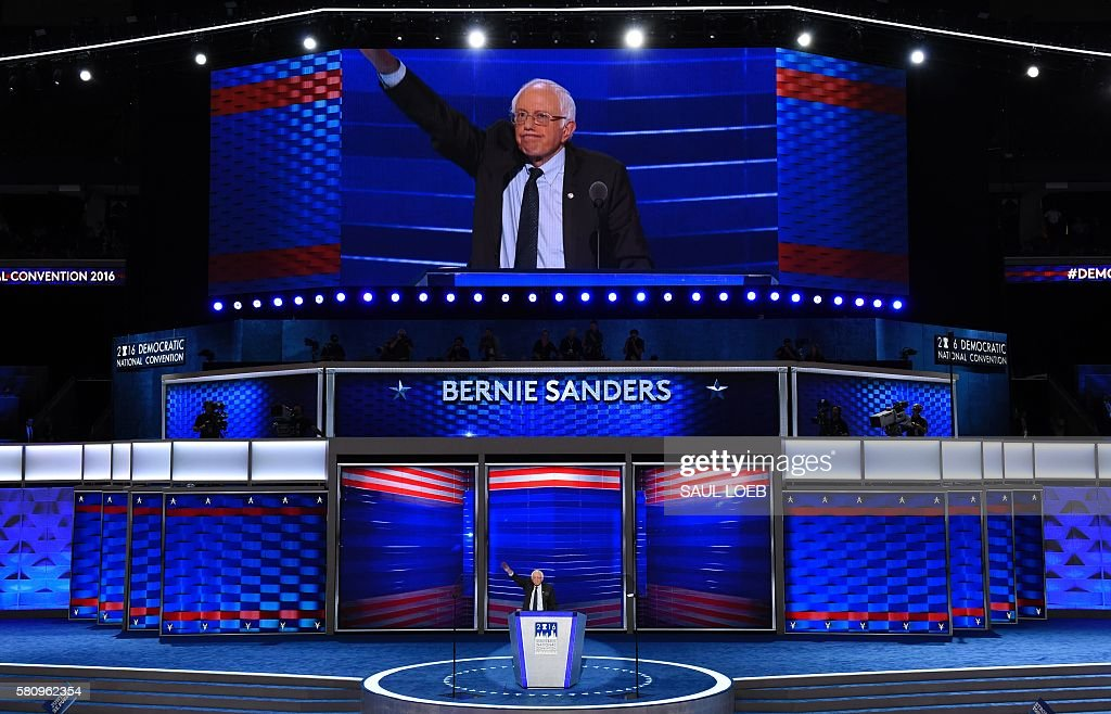 TOPSHOT - Vermont Senator and former Democratic presidential candidate Bernie Sanders waves before leaving the stage after speaking on Day 1 of the Democratic National Convention at the Wells Fargo Center in Philadelphia, Pennsylvania, July 25, 2016. / AFP / SAUL