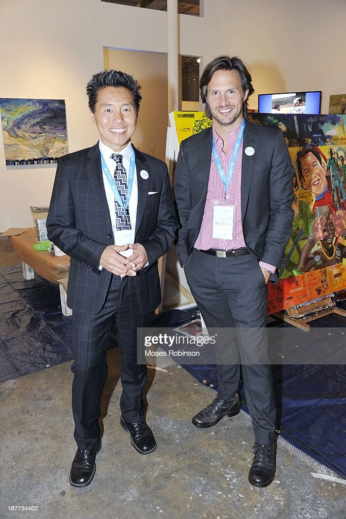 Vern Yip and guest attend The UNICEF Experience at Mason Murer Fine Art Gallery on April 28, 2013 in Atlanta, Georgia.