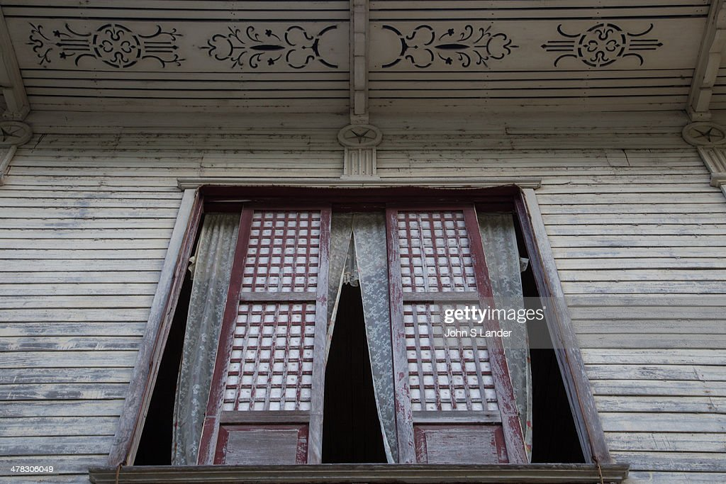Vernacular Filipino architecture on the island of Siquijor often includes gingerbread details carved into the eaves or window frames Though evocative...