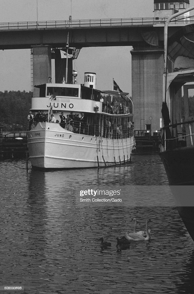 Vernacular snapshot photograph of bridge and ferry, 1966. (Photo by Smith Collection/Gado/Getty Images).