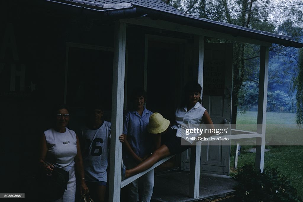 Vernacular snapshot photograph of porch and family, 1966. (Photo by Smith Collection/Gado/Getty Images).