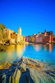 Vernazza village, church, rocks and sea harbor on sunset, Seascape in Five lands, Cinque Terre National Park, Liguria Italy Europe. Long Exposure.