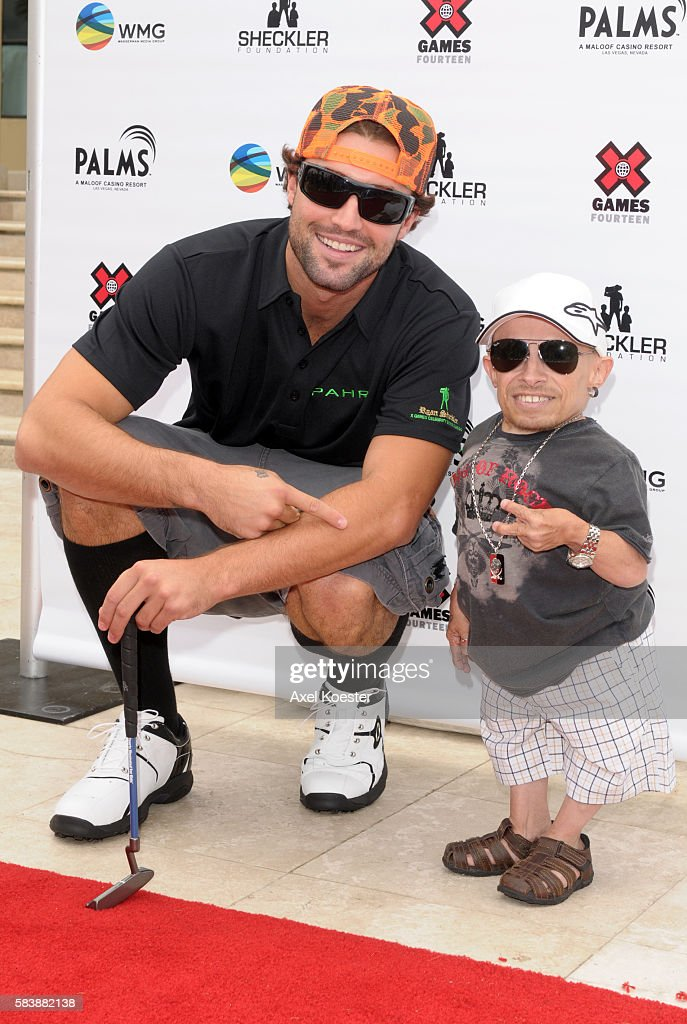 Verne Troyer and Brody Jenner arrive at the X Games Celebrity Skins Classic golf tournament for charity at Trump National Golf Club in Rancho Palos...