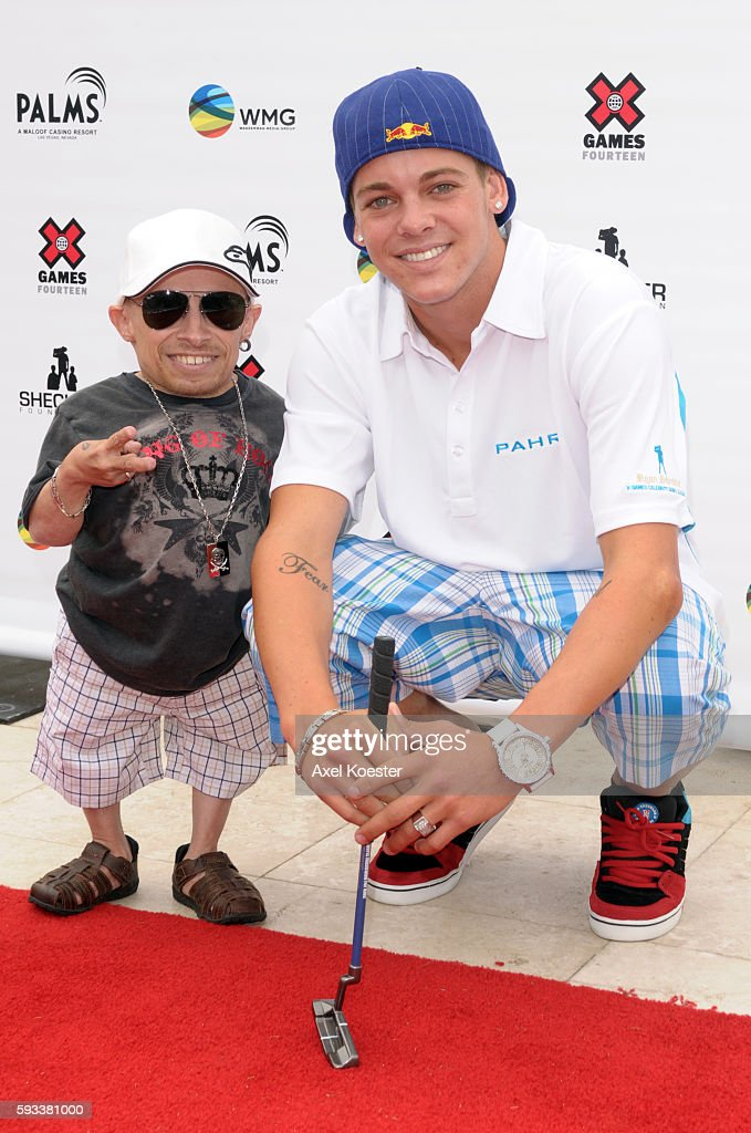 Verne Troyer and Ryan Shekler arrive at the X Games Celebrity Skins Classic golf tournament for charity at Trump National Golf Club in Rancho Palos...