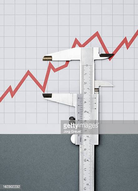 Vernier caliper measuring a line graph