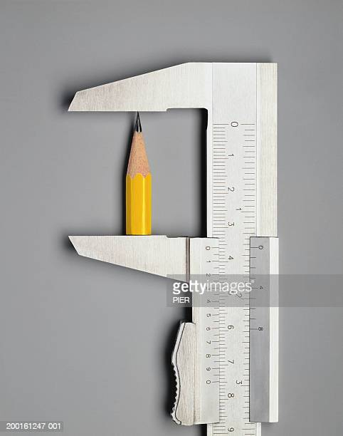 Vernier calliper measuring pencil, close-up