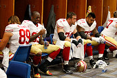 Vernon Davis Joe Staley and Mike Iupati of the San Francisco 49ers relax in the locker room prior to the game against the St Louis Rams at the Edward...