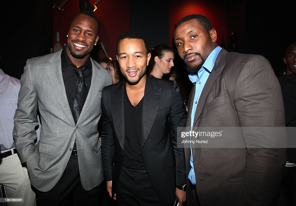 Vernon Davis John Legend and Navorro Bowman attend The Blitz at Sensu on February 4 2012 in Indianapolis Indiana
