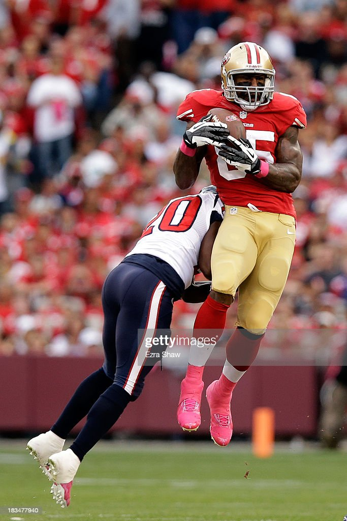 Vernon Davis #85 of the San Francisco 49ers catches a pass against Ed Reed #20 of the Houston Texans during their game at Candlestick Park on October 6, 2013 in San Francisco, California.