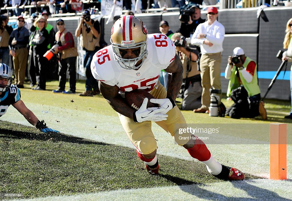 <a gi-track='captionPersonalityLinkClicked' href=/galleries/search?phrase=Vernon+Davis&family=editorial&specificpeople=592553 ng-click='$event.stopPropagation()'>Vernon Davis</a> #85 of the San Francisco 49ers catches a touchdown in the second quarter against the Carolina Panthers during the NFC Divisional Playoff Game at Bank of America Stadium on January 12, 2014 in Charlotte, North Carolina.