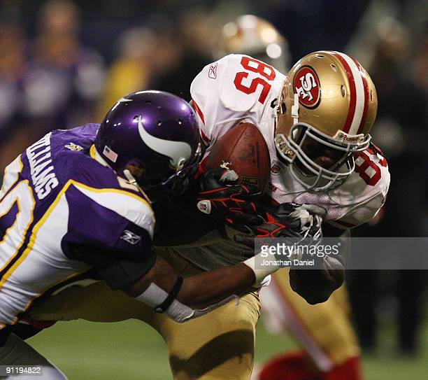 Vernon Davis of the San Francisco 49ers catches a touchdown pass as Madieu Williams of the Minnesota Vikings tries to defend at the Hubert H Humphrey...