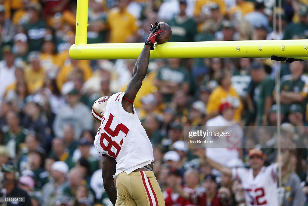 Vernon Davis of the San Francisco 49ers dunks the football over the goal post after catching a fouryard touchdown pass in the third quarter of the...