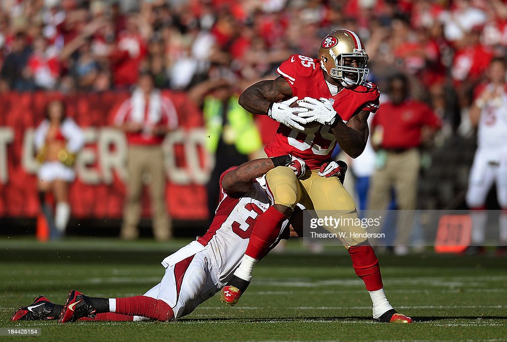 Vernon Davis #85 of the San Francisco 49ers gets tackled by Yeremiah Bell #37 of the Arizona Cardinals during the fourth quarter at Candlestick Park on October 13, 2013 in San Francisco, California. The 49ers won the game 32-20.