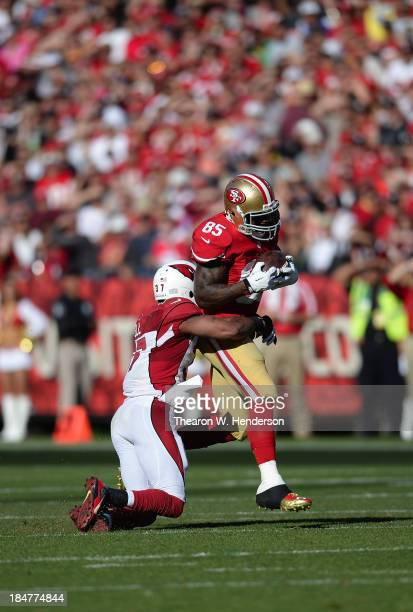 Vernon Davis of the San Francisco 49ers gets tackled by Yeremiah Bell of the Arizona Cardinals during the fourth quarter at Candlestick Park on...