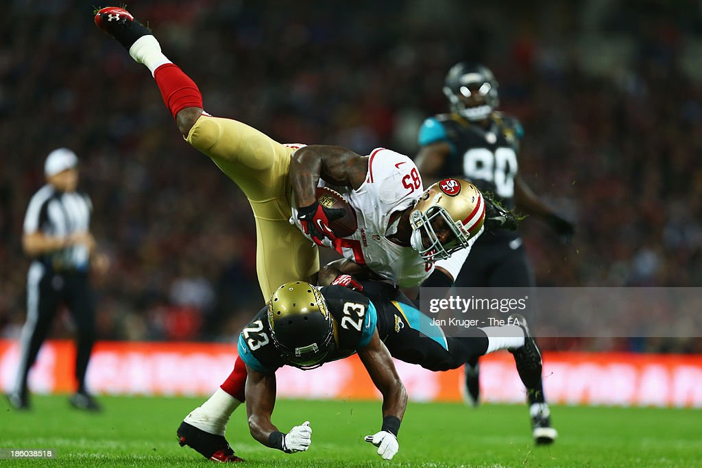 Vernon Davis of the San Francisco 49ers in tackled by Alan Ball of the Jacksonville Jaguars during the NFL International Series game between San...
