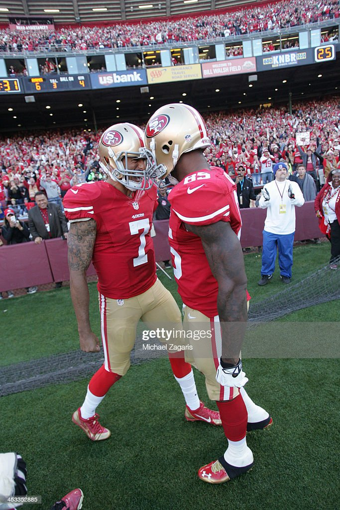 Vernon Davis of the San Francisco 49ers is congratulated by Colin Kaepernick after scoring on a 17yard touchdown reception during the game against...