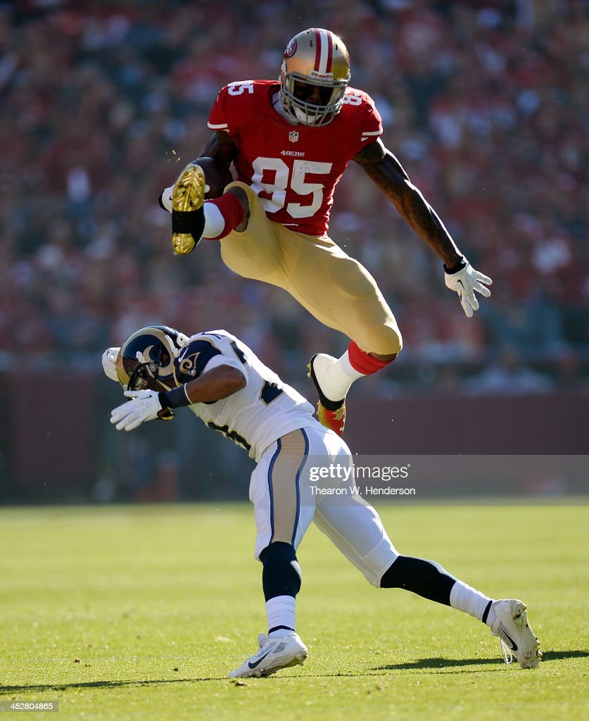 Vernon Davis of the San Francisco 49ers leaps over would be tackler Rodney McLeod of the St Louis Rams during the first quarter at Candlestick Park...