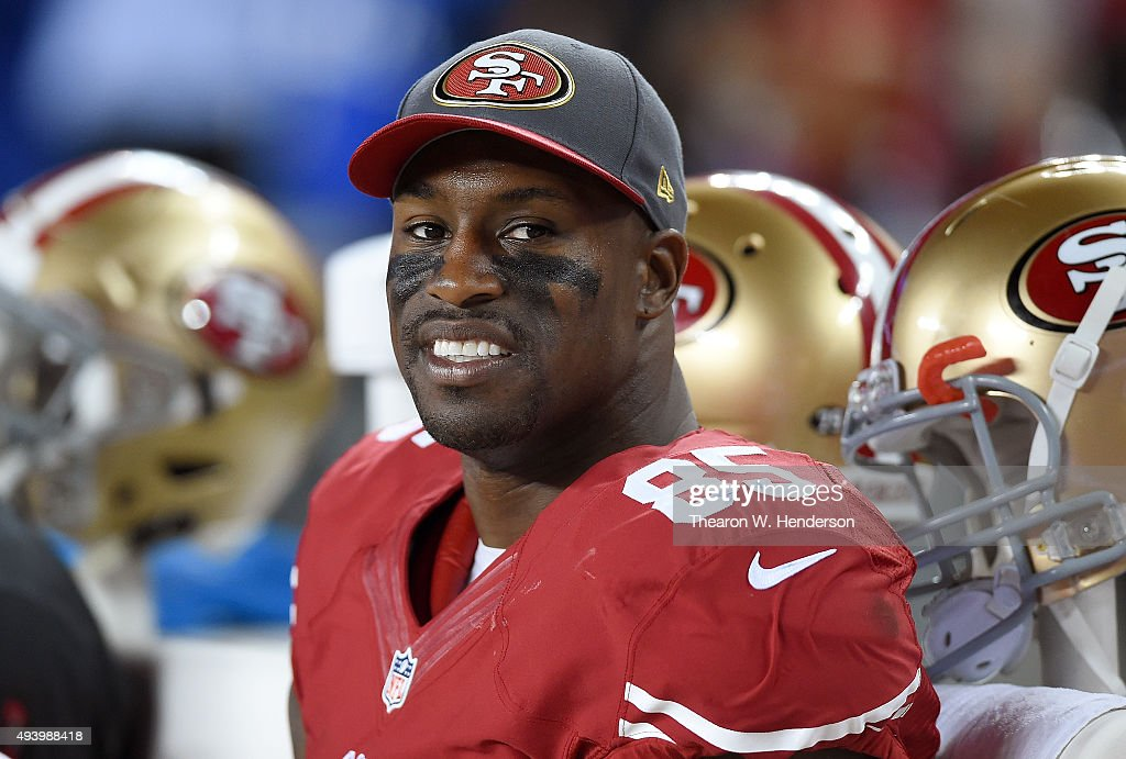 Vernon Davis of the San Francisco 49ers looks on from the sidelines against the Seattle Seahawks in the fourth quarter of an NFL football game at...