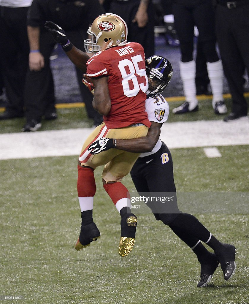 Vernon Davis (85) of the San Francisco 49ers makes a catch in front of Bernard Pollard (31) of the Baltimore Ravens during first-half action in Super Bowl XLVII at the Mercedes-Benz Superdome in New Orleans, Louisiana, Sunday, February 3, 2013.