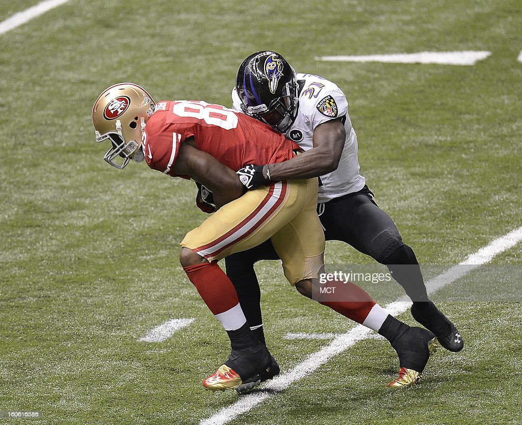Vernon Davis (85) of the San Francisco 49ers makes a reception in front of Bernard Pollard (31) of the Baltimore Ravens in the first half of Super Bowl XLVII at the Mercedes-Benz Superdome in New Orleans, Louisiana, Sunday, February 3, 2013.