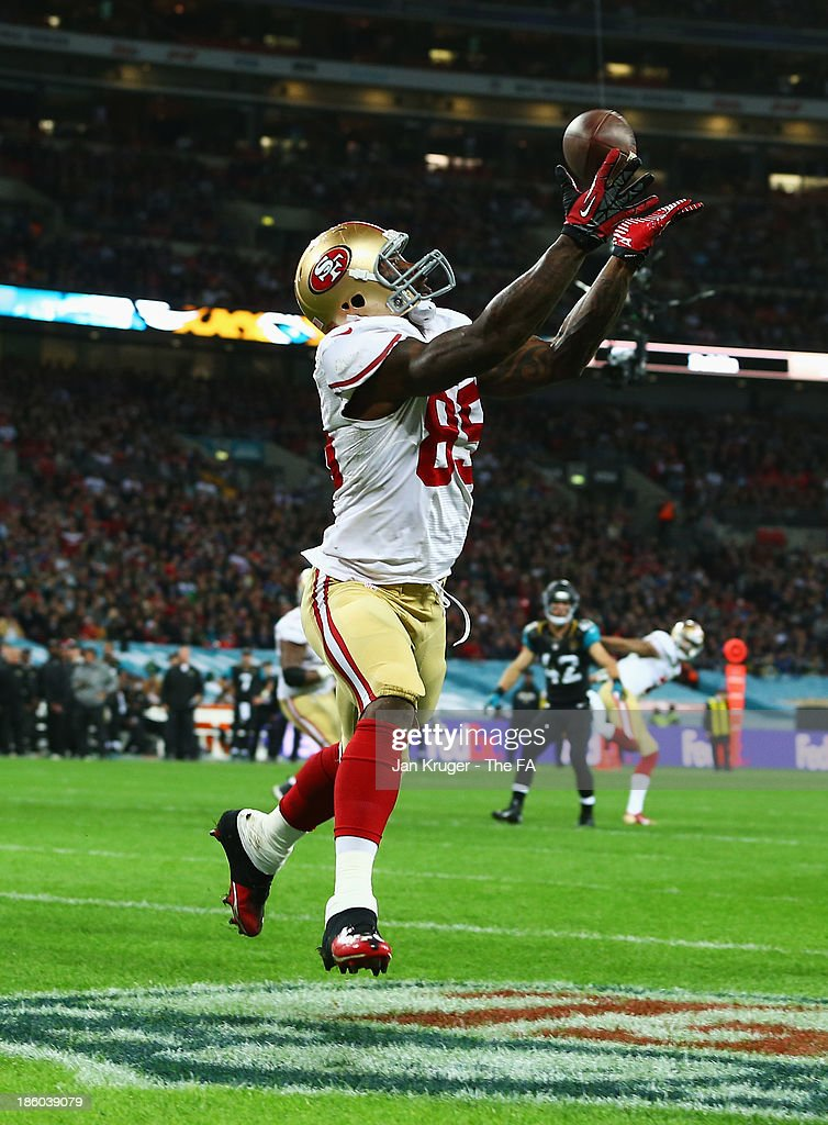 Vernon Davis of the San Francisco 49ers scores a touchdown during the NFL International Series game between San Francisco 49ers and Jacksonville...