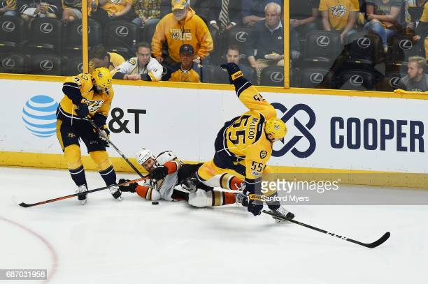 Vernon Fiddler and Cody McLeod of the Nashville Predators vie for the puck with Ryan Getzlaf of the Anaheim Ducks during the second period in Game...