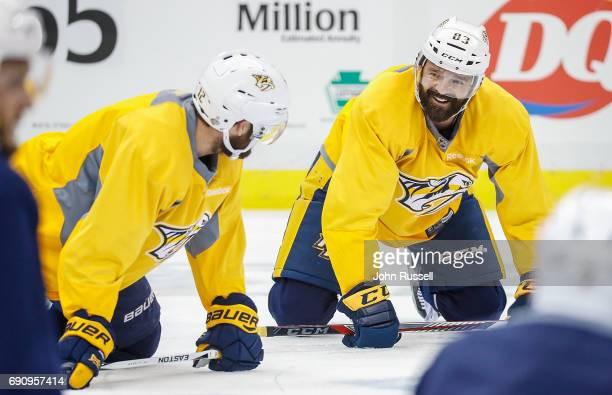 Vernon Fiddler and Mike Fisher of the Nashville Predators stretch during practice prior to Game Two of the 2017 NHL Stanley Cup Final at PPG Paints...