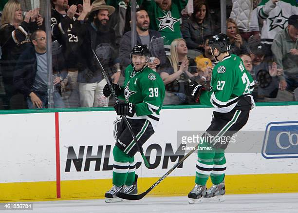 Vernon Fiddler and Travis Moen of the Dallas Stars celebrate a goal against the Boston Bruins at the American Airlines Center on January 20 2015 in...