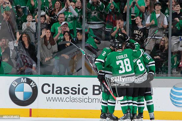 Vernon Fiddler Jyrki Jokipakka and Trevor Daley of the Dallas Stars celebrate a goal against the New Jersey Devils at the American Airlines Center on...
