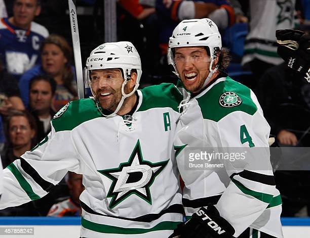 Vernon Fiddler of the Dallas Stars celeberates his first goal of the season against the New York Islanders along with Brenden Dillon at the Nassau...