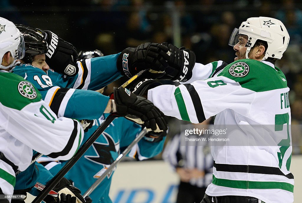 <a gi-track='captionPersonalityLinkClicked' href=/galleries/search?phrase=Vernon+Fiddler&family=editorial&specificpeople=208086 ng-click='$event.stopPropagation()'>Vernon Fiddler</a> #38 of the Dallas Stars exchange punches with <a gi-track='captionPersonalityLinkClicked' href=/galleries/search?phrase=Mike+Brown+-+American+Ice+Hockey+Right+Winger&family=editorial&specificpeople=7275813 ng-click='$event.stopPropagation()'>Mike Brown</a> #18 of the San Jose Sharks during the first period at SAP Center on December 21, 2013 in San Jose, California.