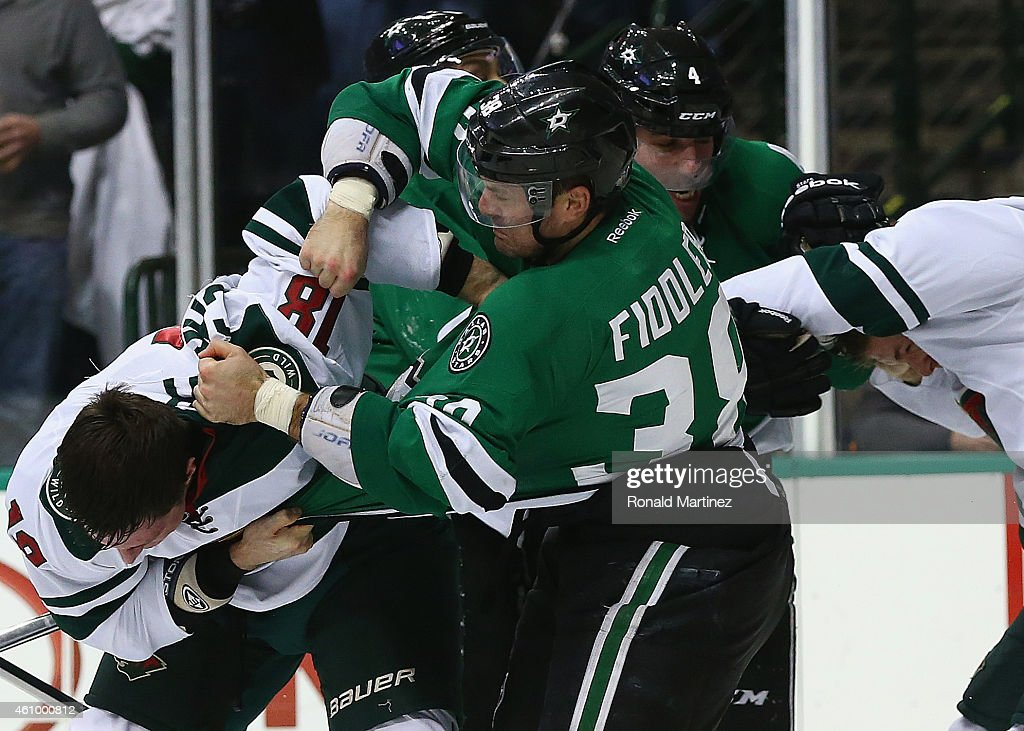 <a gi-track='captionPersonalityLinkClicked' href=/galleries/search?phrase=Vernon+Fiddler&family=editorial&specificpeople=208086 ng-click='$event.stopPropagation()'>Vernon Fiddler</a> #38 of the Dallas Stars fights with <a gi-track='captionPersonalityLinkClicked' href=/galleries/search?phrase=Ryan+Carter+-+Ice+Hockey+Player&family=editorial&specificpeople=3144941 ng-click='$event.stopPropagation()'>Ryan Carter</a> #18 of the Minnesota Wild as <a gi-track='captionPersonalityLinkClicked' href=/galleries/search?phrase=Jason+Demers&family=editorial&specificpeople=2282534 ng-click='$event.stopPropagation()'>Jason Demers</a> #4 of the Dallas Stars fights with <a gi-track='captionPersonalityLinkClicked' href=/galleries/search?phrase=Stu+Bickel&family=editorial&specificpeople=4862669 ng-click='$event.stopPropagation()'>Stu Bickel</a> #4 of the Minnesota Wild in the second period at American Airlines Center on January 3, 2015 in Dallas, Texas.