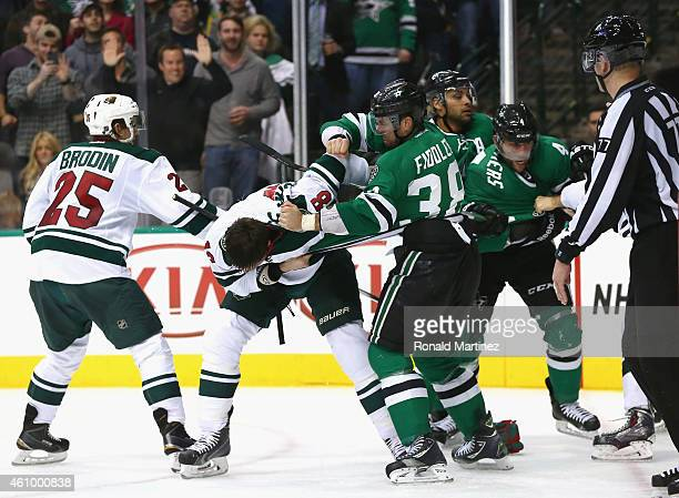 Vernon Fiddler of the Dallas Stars fights with Ryan Carter of the Minnesota Wild as Jason Demers of the Dallas Stars fights with Stu Bickel of the...