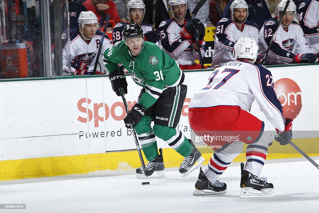 Vernon Fiddler #38 of the Dallas Stars handles the puck against Ryan Murray #27 of the Columbus Blue Jackets at the American Airlines Center on April 9, 2014 in Dallas, Texas.
