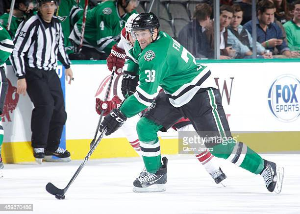 Vernon Fiddler of the Dallas Stars handles the puck against the Arizona Coyotes at the American Airlines Center on November 20 2014 in Dallas Texas