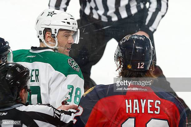 Vernon Fiddler of the Dallas Stars has words with Jimmy Hayes of the Florida Panthers after a hard check at the BBT Center on April 6 2014 in Sunrise...
