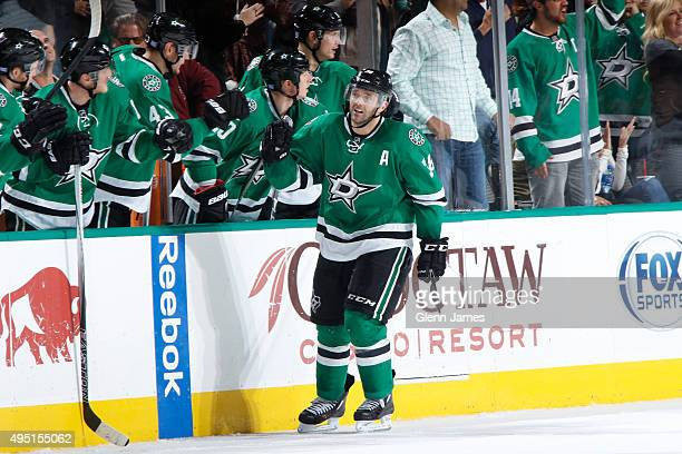 Vernon Fiddler of the Dallas Stars heads down the high five line after scoring a goal against the San Jose Sharks at the American Airlines Center on...
