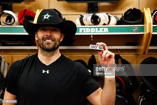 Vernon Fiddler of the Dallas Stars poses with the puck after scoring his 100th career goal against the New Jersey Devils at the American Airlines...