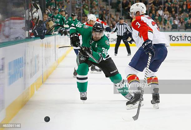 Vernon Fiddler of the Dallas Stars skates for control of the puck against Steven Kampfer of the Florida Panthers in the first period at American...