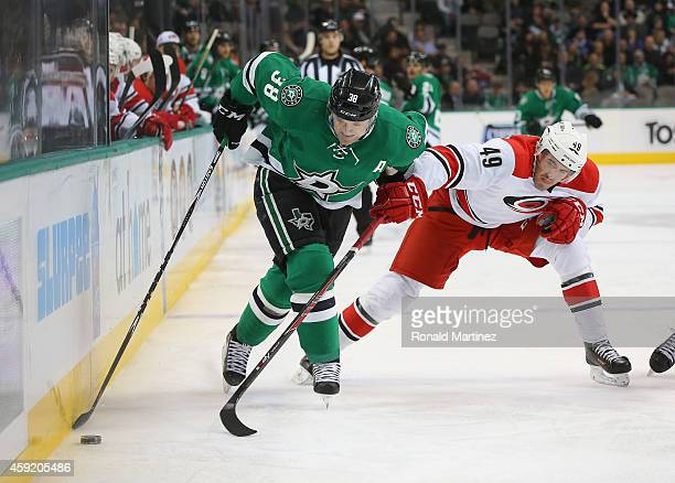 Vernon Fiddler of the Dallas Stars skates the puck against Victor Rask of the Carolina Hurricanes in the first period at American Airlines Center on...