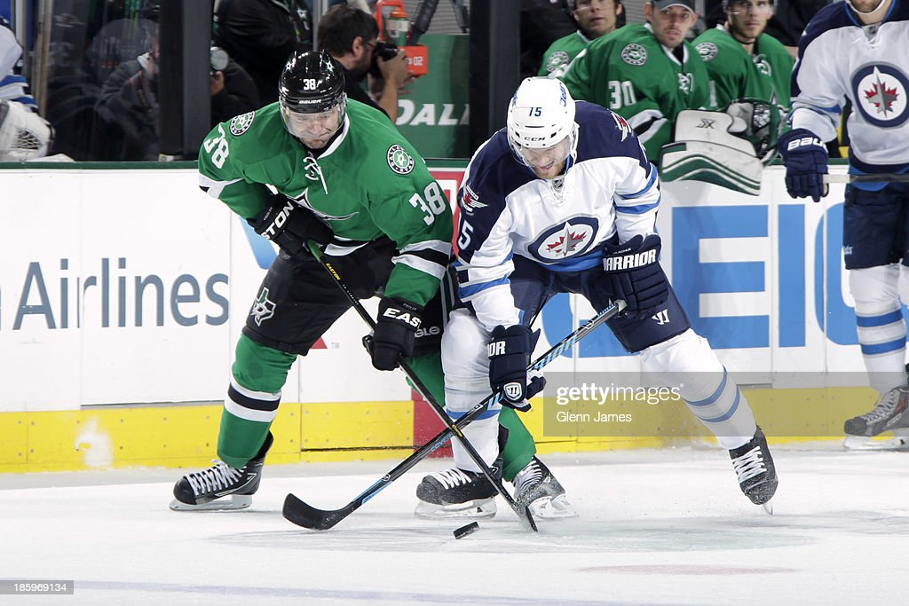 <a gi-track='captionPersonalityLinkClicked' href=/galleries/search?phrase=Vernon+Fiddler&family=editorial&specificpeople=208086 ng-click='$event.stopPropagation()'>Vernon Fiddler</a> #38 of the Dallas Stars tries to keep the puck away against <a gi-track='captionPersonalityLinkClicked' href=/galleries/search?phrase=Matt+Halischuk&family=editorial&specificpeople=714406 ng-click='$event.stopPropagation()'>Matt Halischuk</a> #15 of the Winnipeg Jets at the American Airlines Center on October 26, 2013 in Dallas, Texas.
