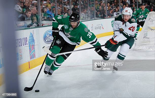 Vernon Fiddler of the Dallas Stars tries to keep the puck away against Ryan Suter of the Minnesota Wild at the American Airlines Center on March 8...