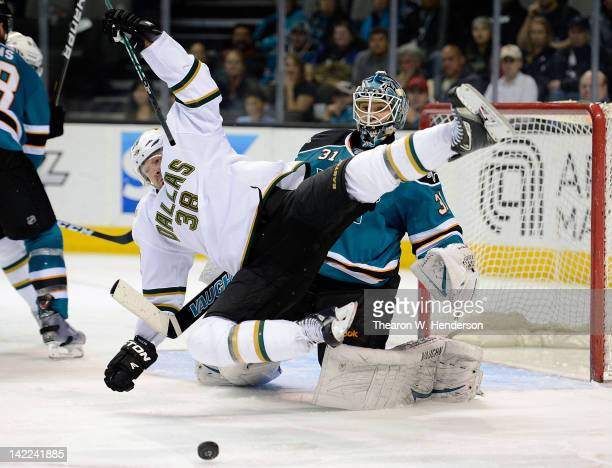Vernon Fiddler of the Dallas Stars trips over goaltender Antti Niemi during an NHL hockey game at HP Pavilion at San Jose on March 31 2012 in San...