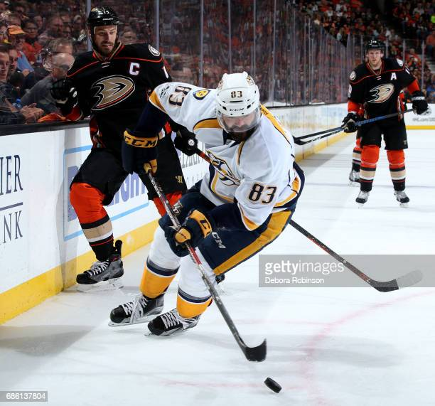 Vernon Fiddler of the Nashville Predators handles the puck against Ryan Getzlaf of the Anaheim Ducks in Game Five of the Western Conference Final...
