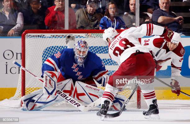 Vernon Fiddler of the Phoenix Coyotes scores against goaltender Henrik Lundqvist of the New York Rangers in the second period on October 26 2009 at...