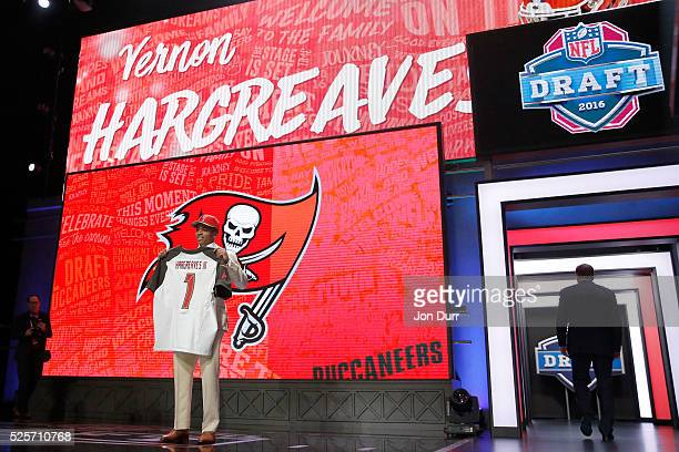 Vernon Hargreaves III of Florida holds up a jersey after being picked overall by the Tampa Bay Buccaneers during the first round of the 2016 NFL...