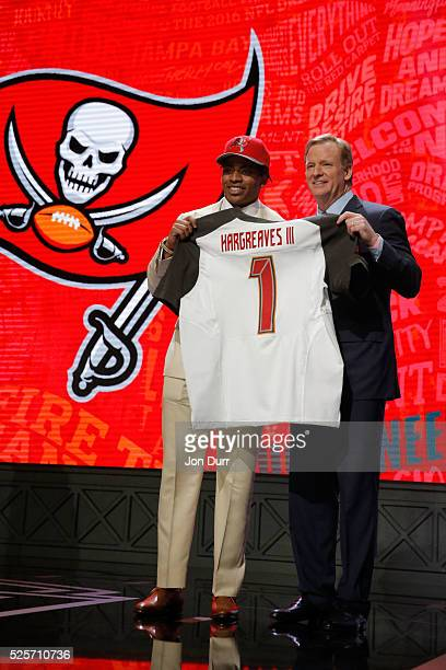 Vernon Hargreaves III of Florida holds up a jersey with NFL Commissioner Roger Goodell after being picked overall by the Tampa Bay Buccaneers during...