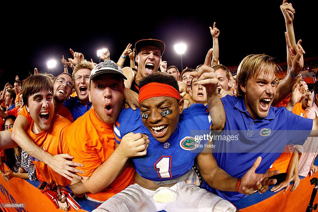 Vernon Hargreaves III of the Florida Gators celebrates after defeating the Kentucky Wildcats in triple overtime at Ben Hill Griffin Stadium on...