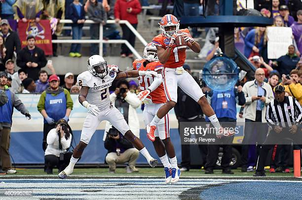 Vernon Hargreaves III of the Florida Gators intercepts a pass intended for Justin Hardy of the East Carolina Pirates during the fourth quarter of the...