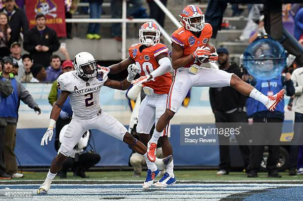 Vernon Hargreaves III of the Florida Gators intercepts a pass intended for Justin Hardy of the East Carolina Pirates during the Birmingham Bowl at...